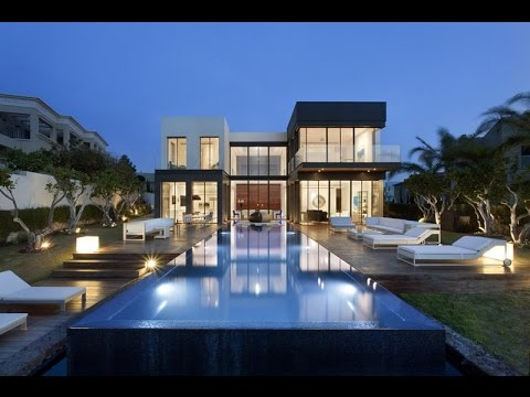 Luxury modern house with clean modern lines and floor to for Luxury home windows