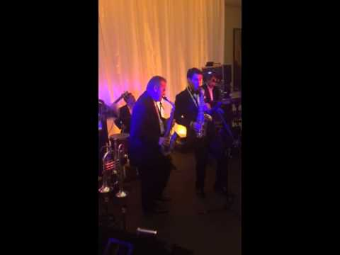 Dave Duncan playing saxophone at his own wedding reception