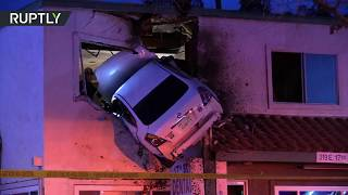 Car plows into 2nd floor of office building