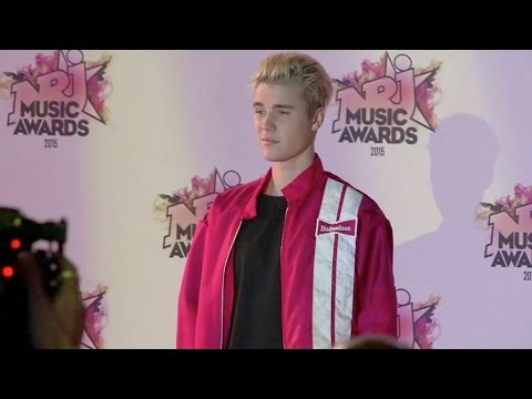 Justin Bieber Looks bored on the red carpet of the NRJ Music Awards 2015 in Cannes.