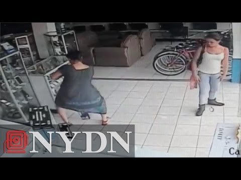 Raw: Woman in Costa Rica steals TV by hiding it under dress