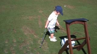 24 month old golfer at driving range