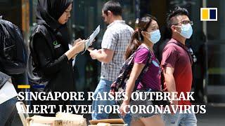 Singapore raises outbreak alert level after signs of community spread of coronavirus