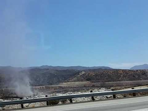 Dust Devil on the Antelope Valley Freeway (14) and Sand Fire in back ground, Sand Canyon, CA