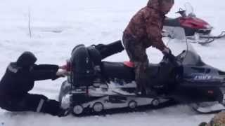 Russian man gets sucked into a snowmobile! His friends help ..after laughing!! bagz.co.uk