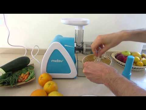 Midzu Slow Juicer juicing mung bean and wheat sprouts