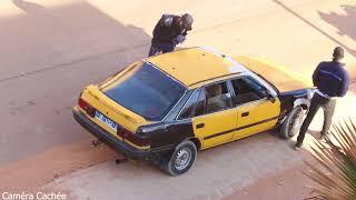 Mahfousse Camera Cachee Examen des taximan