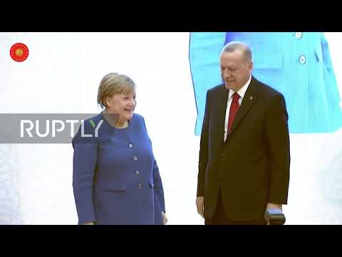 Erdogan Gives Merkel Antique Mirror And Helmet At University Opening Ceremony
