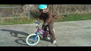 Isaac and Megan ride their bikes with no training wheels!
