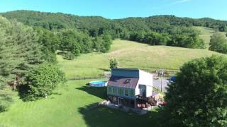 60 acre farm offered for sale with this passive solar home in Big Valley, Highland County, Virginia