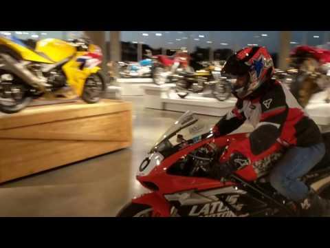 Jason Disalvo riding his Ducati through the Barber's Vintage Motorsports Museum