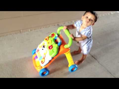 11 month old baby walking with Vtech walker