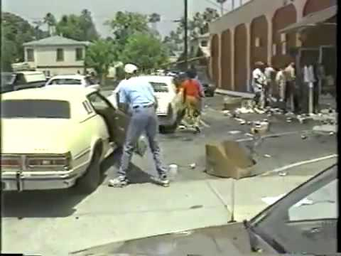 Flashback 1992 LA Riots - Defenseless Store Owner Confronts Rioters with Hammer