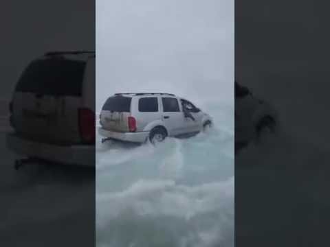 Red Lake, Minnesota Ice fisher's driving over flooded ice.