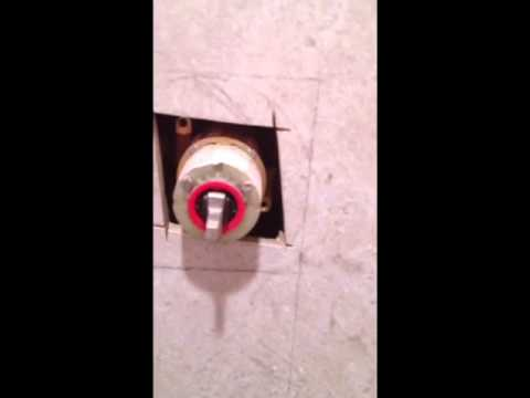 How to cut a shower valve hole in tile - YouTube
