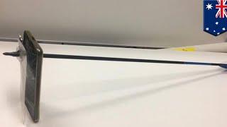 Australian guy blocks arrow with smartphone - TomoNews