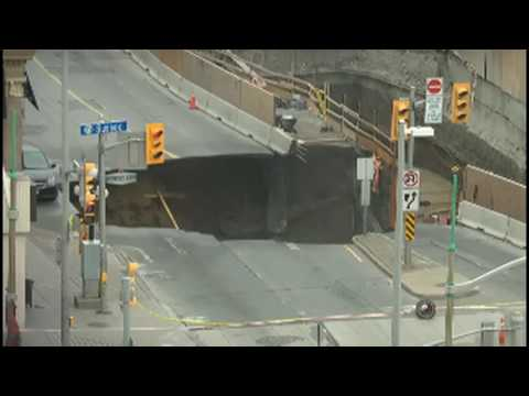 Giant Sinkhole Devours Car and Roadway In Ottawa