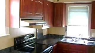 Cherry Cabinets Pergo Floor Black Appliances  New Kitchen blue Formica counter tops