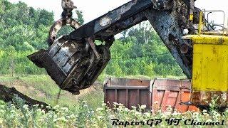 Old EKG-4.6 rope shovel loads dirt on KAMAZ-6520 trucks