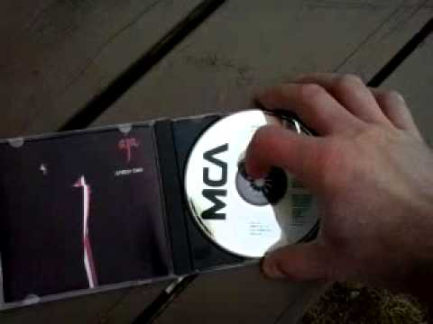 How to correctly remove a CD from a jewel case.