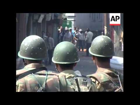 Protesters and police clash in Indian Kashmir