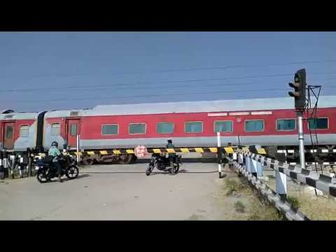 The Red Train thrashes a Level crossing-Indian Railways YPR GKP Exp