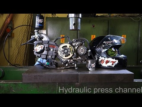 Crushing running 4-stroke motor and motorcycle helmet with hydraulic press