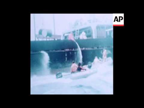 SYND 16 7 79 SHIP CARRYING NUCLEAR WASTE HARRIED BY GREENPEACE BOATS