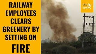Railway employees indulge in grass burning along railway track