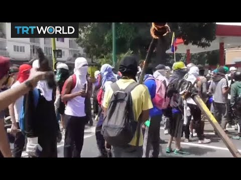 Security forces clash with opposition protesters in Venezuela