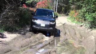 Through a mud pit with the 2014 Range Rover Supercharhed