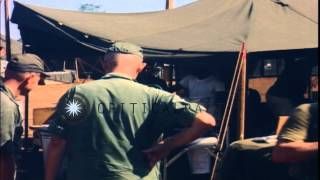 U S Colonel James J Moran and officers inspect mess tents as US Army cooks prepar...HD Stock Footage