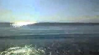 Stranden, havet och horisonten i Agia Marina på Aegina i Grekland