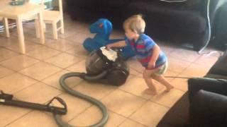 Bastian vacuuming the floor.... Thumbnail
