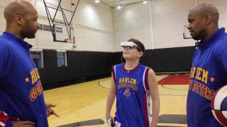 Legally Blind Boy uses eSight to see Harlem Globetrotters