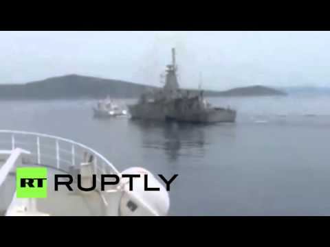 Greek navy gunship chasing Turkish coastguard threatening Greek fisherman