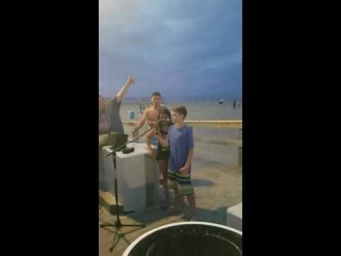 Amazing Kid stops to sing karaoke unexpectedly on the Boardwalk in OCMD and Blows the Crowd away