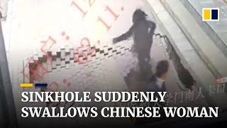 Sinkhole suddenly swallows Chinese woman