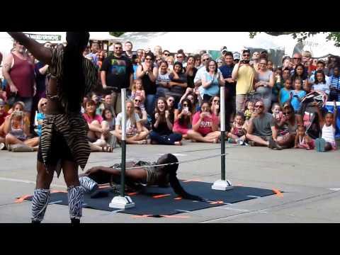 Zuzu African Acrobats at the Omaha Summer arts festival -Super low limbo!