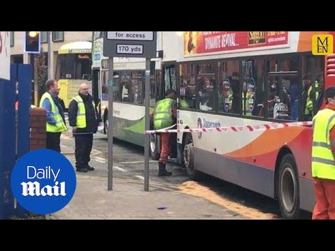 Emergency services surround area of Manchester bus crash - Daily Mail