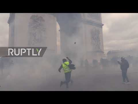 France: Stones and tear gas fly as Paris Yellow Vests demo turns violent