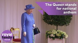 The military band plays the royal anthem as the Queen arrives at th...