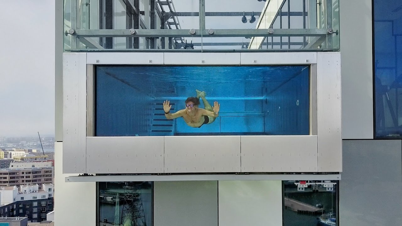 Glass swimming pool 1000 feet in the sky youtube for Glass swimming pool