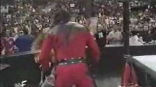 KANE REMOVES MASK AND ITS THE UNDERTAKER