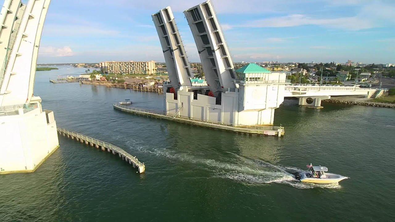 Johns pass bridge fishing boat 39 s youtube for Johns pass fishing