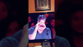 Simon Cowell confused and pondering decision
