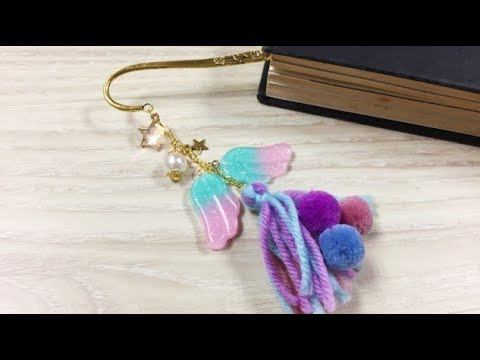 DoreenBeads Jewelry Making Tutorial - How to Make Glitter Resin Wing Polyester Tassel Bookmark.