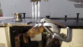 Regulagem de loope da máquina galoneira.