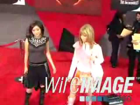 Brenda Song with Ashley Tisdale on the red carpet