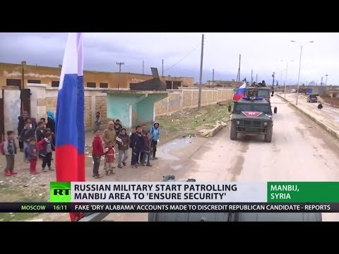 Russian military police begin patrolling Syria's Manbij area to 'ensure security'